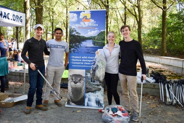 Hilltop Consultants members volunteering at American Rivers' river cleanup event in October 2017